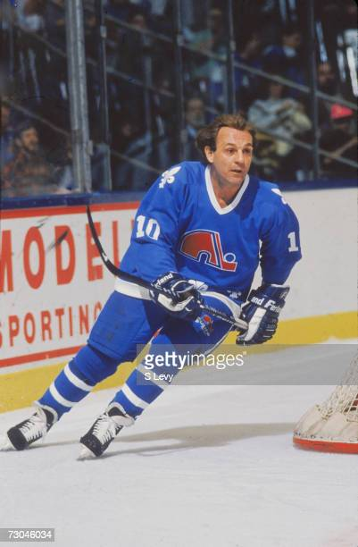 Canadian professional ice hockey player Guy Lafleur of the Quebec Nordiques on the ice behind a goal during a road game late 1980s or early 1990s Guy...