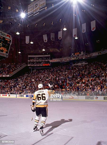 Canadian professional ice hockey player Mario Lemieux of the Pittsburgh Penguins waves to the crowd during the Stanley Cup Finals in a game against...
