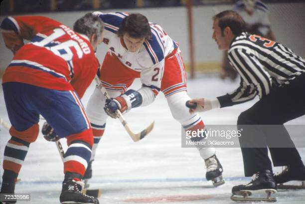 Canadian professional ice hockey player Pete Stemkowski of the New York Rangers faces off against opponent Henri Richard of the Montreal Canadiens on...