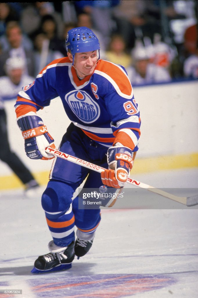 Canadian professional ice hockey player Wayne Gretzky forward of the Edmonton Oilers skates on the ice during a road game mid 1980s