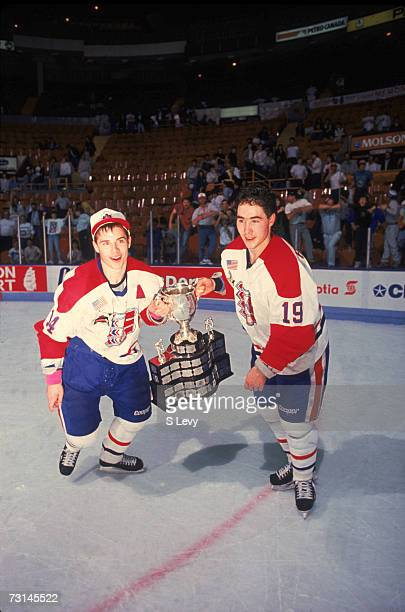 Canadian professional ice hockey players Ray Whitney and Pat Falloon of the Western Hockey League's Spokane Chiefs pose with the trophy on the ice...