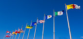 Canadian provinces and territory flags on blue sky in Ottawa