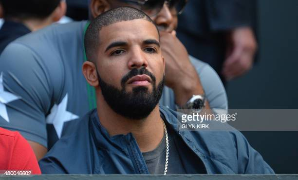 Canadian rapper Drake sits on centre court to watch the women's semifinals matches on day ten of the 2015 Wimbledon Championships at The All England...