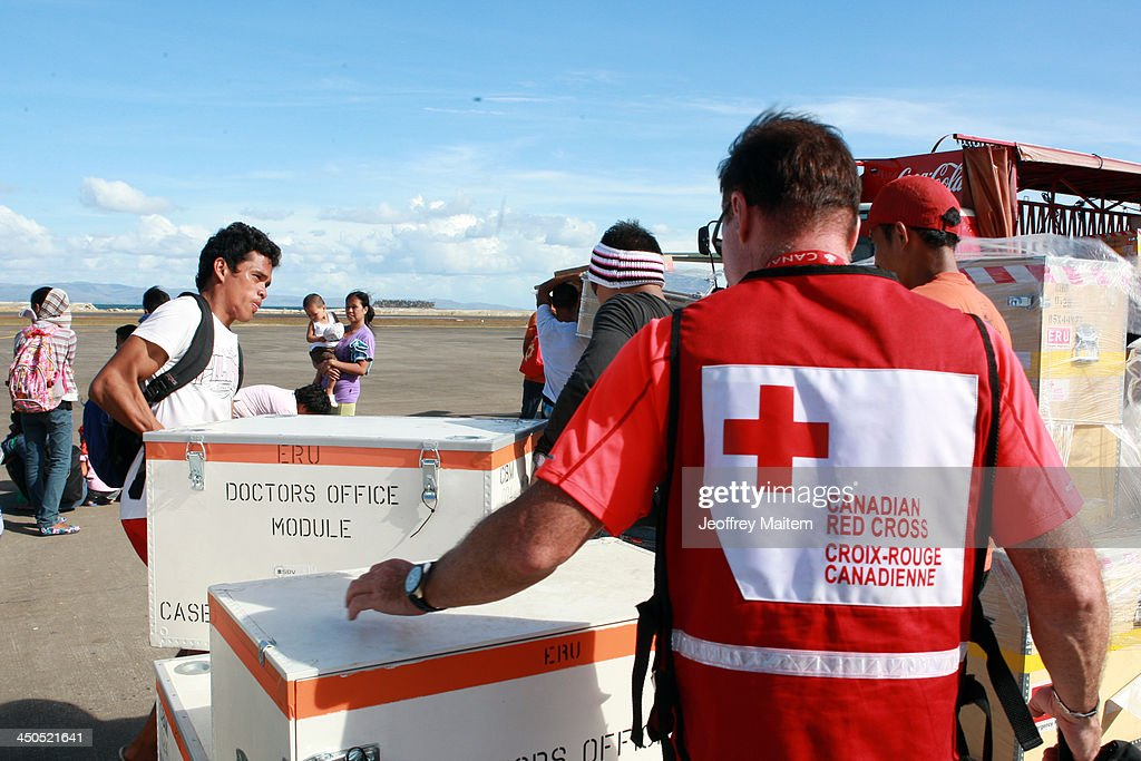 Canadian Red Cross staff supervise the loading of their supplies into a truck for typhoon survivors following the recent super typhoon on November 19...