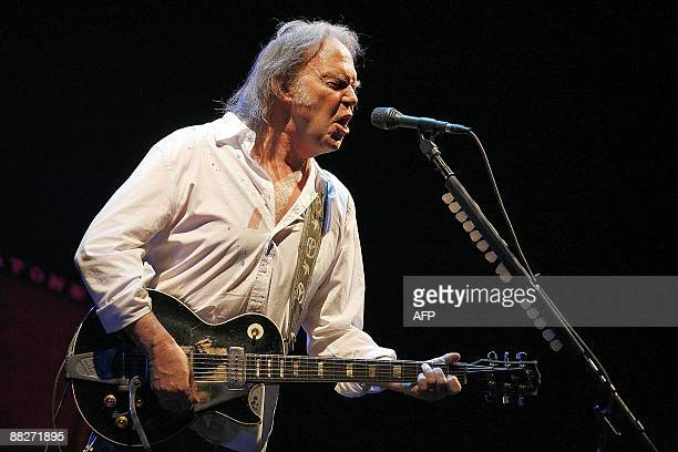 Canadian rock star Neil Young performs during a concert on June 6 2009 at the Antwerp Sportpaleis AFP PHOTO/ BELGA/ JORGE DIRKX