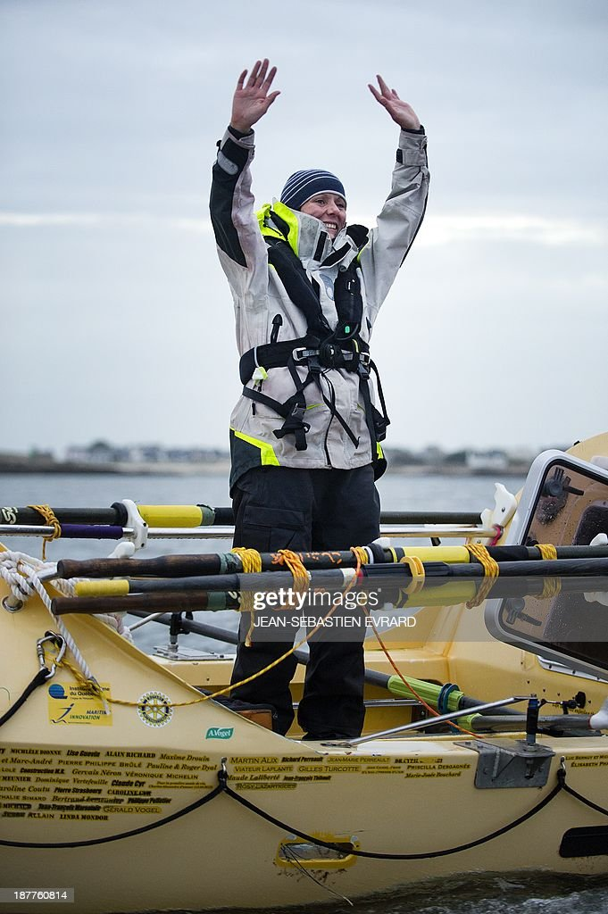 Canadian sailor Mylene Paquette celebrates as she arrives at the Lorient harbour, western France, on November 12, 2013. Mylene Paquette, a 35-year-old from Quebec, is the first North American to have crossed the Atlantic Ocean, a 2,700 nautical mile (4,300-km) long journey, on a rowboat in 129 days between Halifax and Lorient. Ten people have so far crossed the Atlantic from west to east on a rowboat, including two French female sailors. AFP PHOTO / JEAN-SEBASTIEN EVRARD