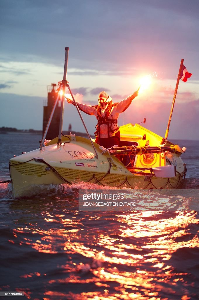 Canadian sailor Mylene Paquette celebrates as she arrives at the Lorient harbour, western France, on November 12, 2013. Mylene Paquette, a 35-year-old from Quebec, is the first North American to have crossed the Atlantic Ocean, a 2,700 nautical mile (4,300-km) long journey, on a rowboat in 129 days between Halifax and Lorient. Ten people have so far crossed the Atlantic from west to east on a rowboat, including two French female sailors.