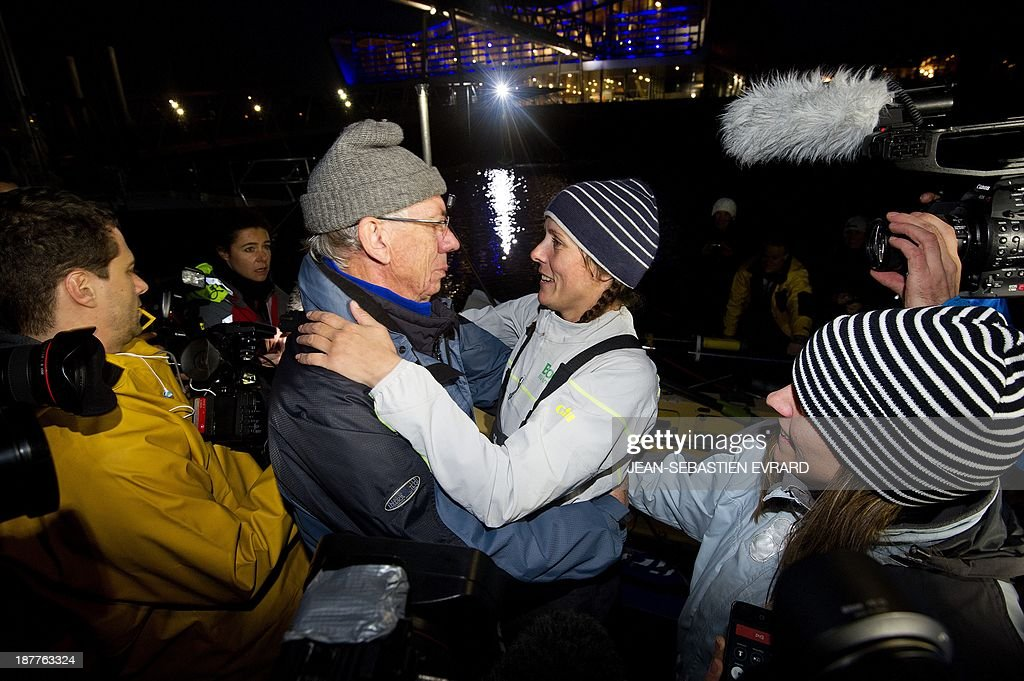 Canadian sailor Mylene Paquette (R) celebrates with her father Jean as she arrives at the Lorient harbour, western France, on November 12, 2013. Mylene Paquette, a 35-year-old from Quebec, is the first North American to have crossed the Atlantic Ocean, a 2,700 nautical mile (4,300-km) long journey, on a rowboat in 129 days between Halifax and Lorient. Ten people have so far crossed the Atlantic from west to east on a rowboat, including two French female sailors. At background, the French late yachtsman Eric Tabarly's Cite de la Voile (sailing city).