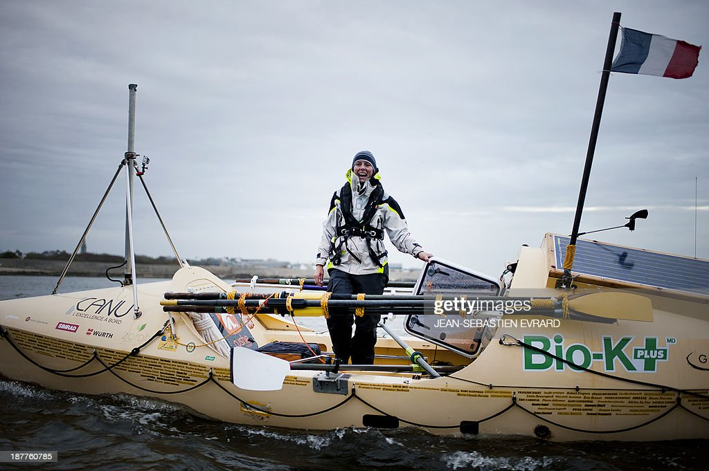 Canadian sailor Mylene Paquette reacts as she arrives at the Lorient harbour, western France, on November 12, 2013. Mylene Paquette, a 35-year-old from Quebec, is the first North American to have crossed the Atlantic Ocean, a 2,700 nautical mile (4,300-km) long journey, on a rowboat in 129 days between Halifax and Lorient. Ten people have so far crossed the Atlantic from west to east on a rowboat, including two French female sailors. AFP PHOTO / JEAN-SEBASTIEN EVRARD