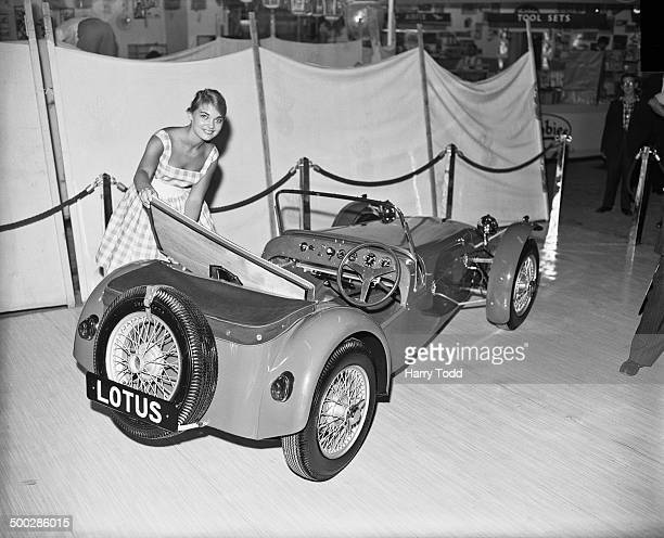 Canadian Sally Hall with a Lotus Seven kit car at the International Handicrafts and Do It Yourself Exhibition at Olympia London 2nd September 1959