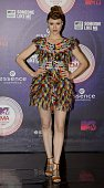 Canadian singer and songwriter Kiesza poses for pictures as she arrives at the 2014 MTV Europe Music Awards in Glasgow Scotland on November 9 2014...