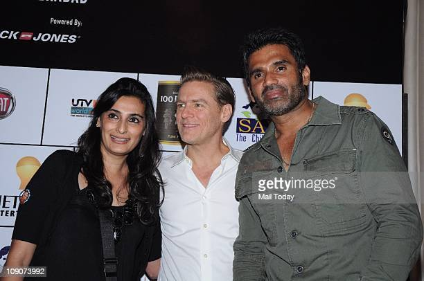 Canadian Singer Bryan Adams at an afterconcert event with Sunil Shetty and his wife Mana Shetty Bryan received $10000 donation for his foundation...