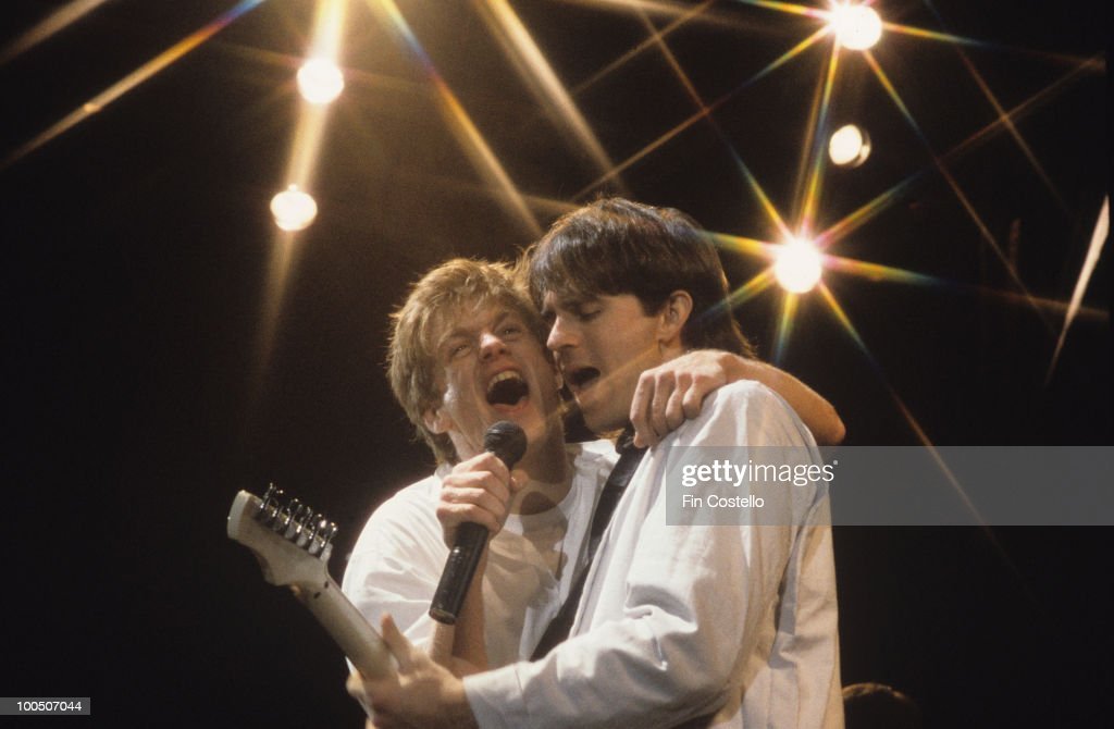 Canadian singer Bryan Adams performs on stage with guitarist Keith Scott circa 1985.