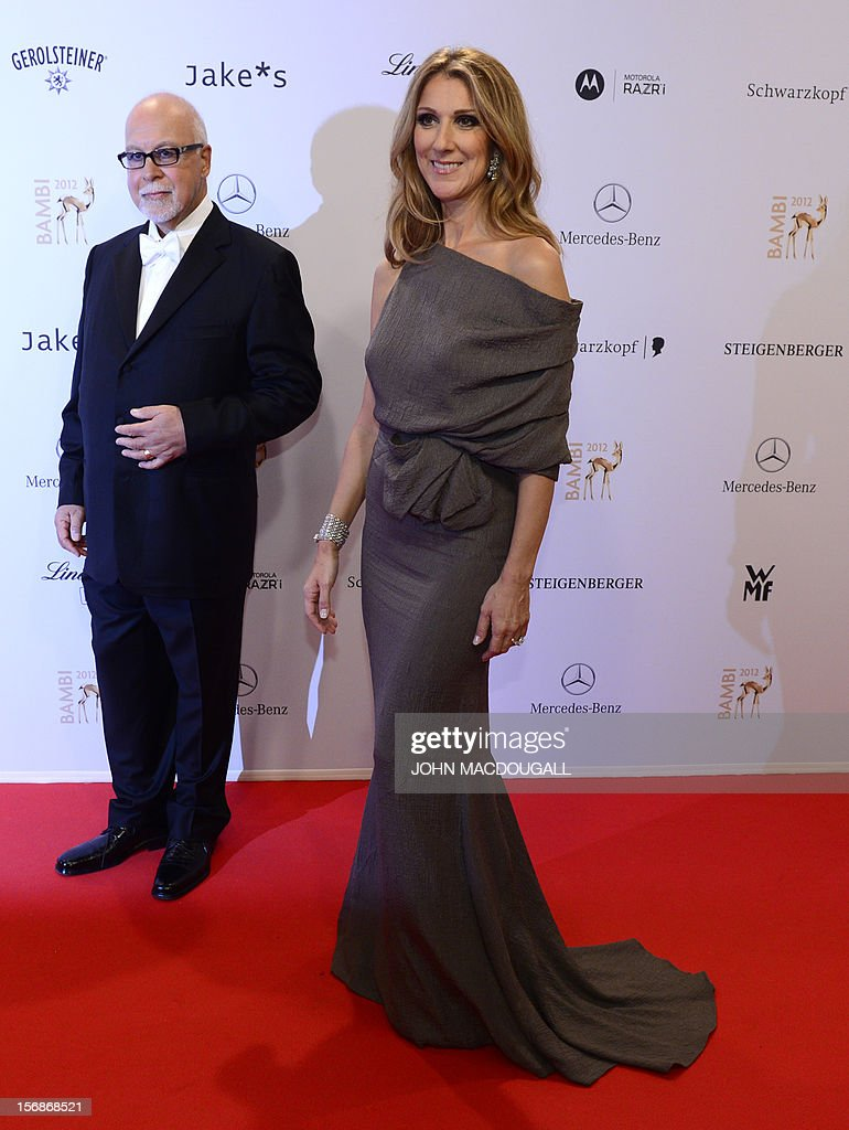 Canadian singer Celine Dion (R) and her husband Rene Angelil pose for photographers as they arrive on the red carpet for the Bambi awards in Duesseldorf, western Germany, on November 22, 2012. The Bambis are the main German media awards. AFP PHOTO / JOHN MACDOUGALL