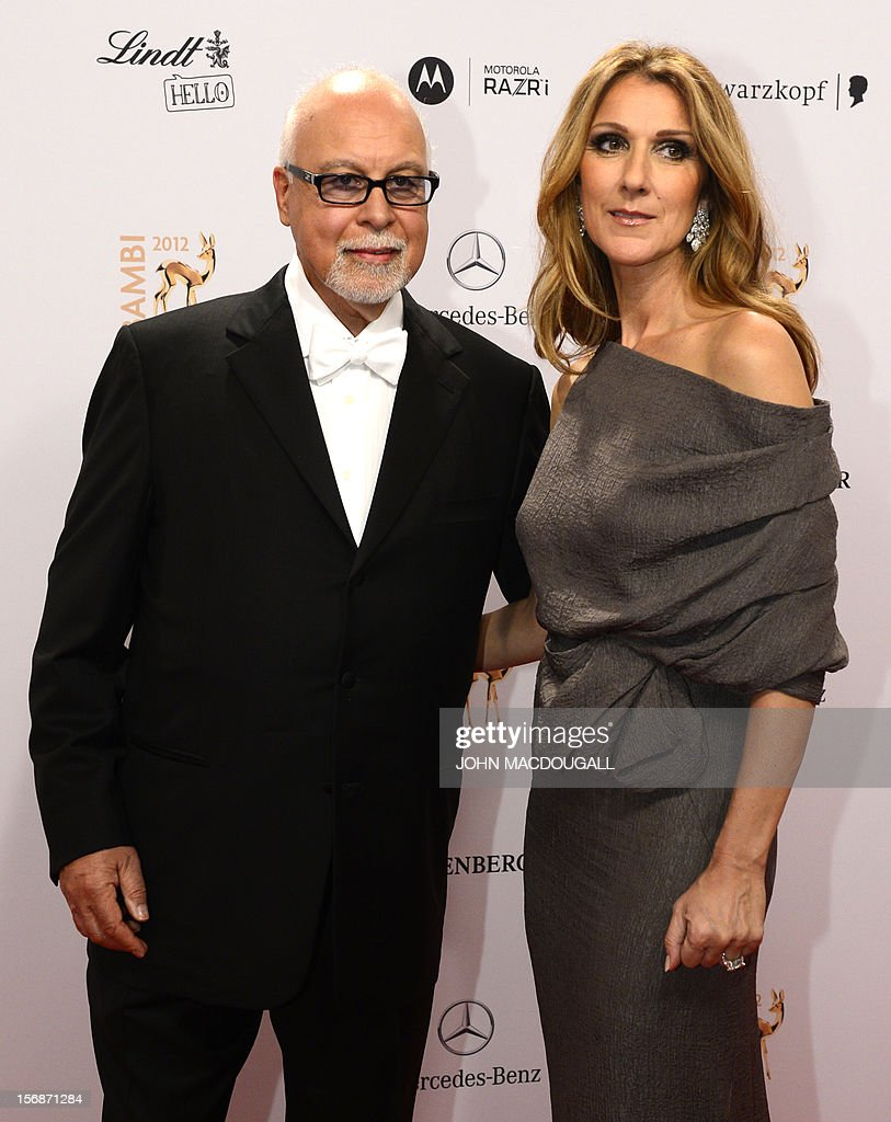 Canadian singer Celine Dion (R) and her husband Rene Angelil pose for photographers as they arrive on the red carpet for the Bambi awards in Duesseldorf, western Germany, on November 22, 2012. The Bambis are the main German media awards.