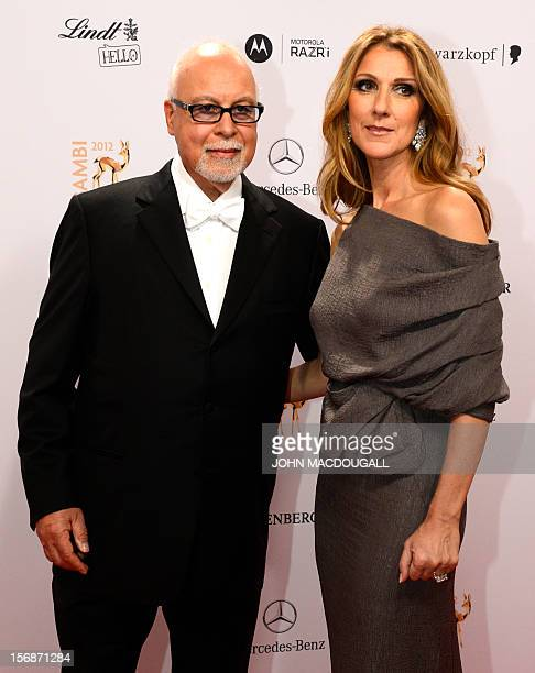 Canadian singer Celine Dion and her husband Rene Angelil pose for photographers as they arrive on the red carpet for the Bambi awards in Duesseldorf...