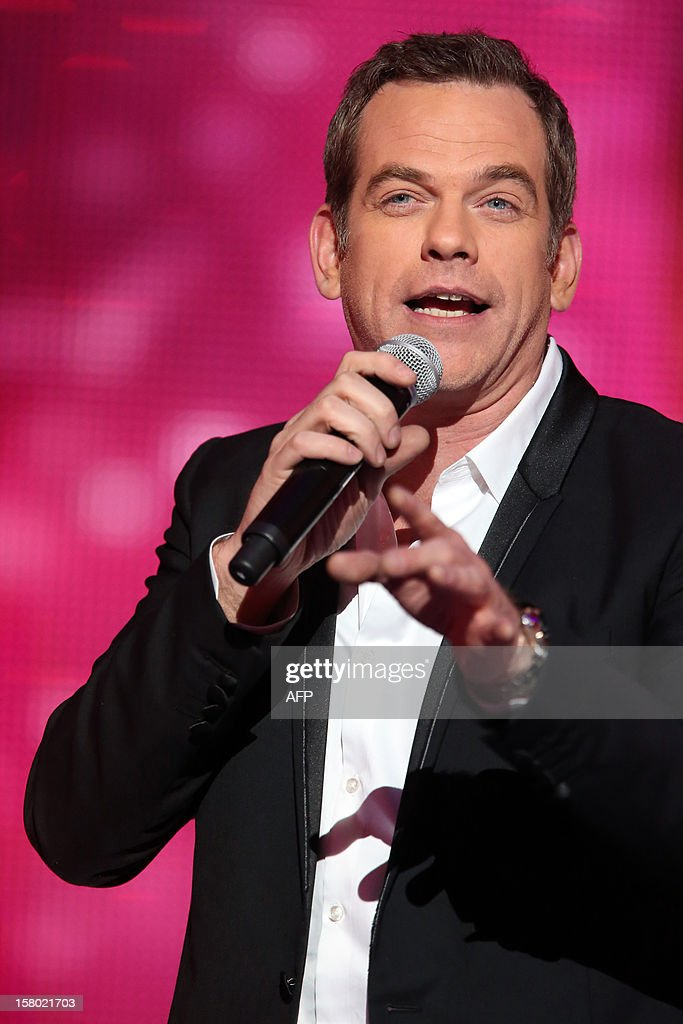 Canadian singer Garou performs during the 26th Telethon, France's biggest annual fund-raising event during 30 hours of live television transmission, on December 8, 2012 in Saint-Denis, north of Paris. The event aims at collecting funds for research on genetic diseases such as myopathy, a neuromuscular disease. This year's edition raised 81,065,239 Euros.