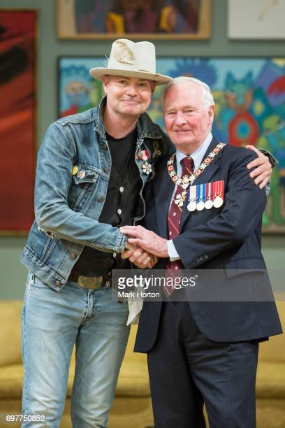 Canadian singer Gord Downie is invested as a Member of the Order of Canada by Governor General of Canada David Johnston at Rideau Hall on June 19...
