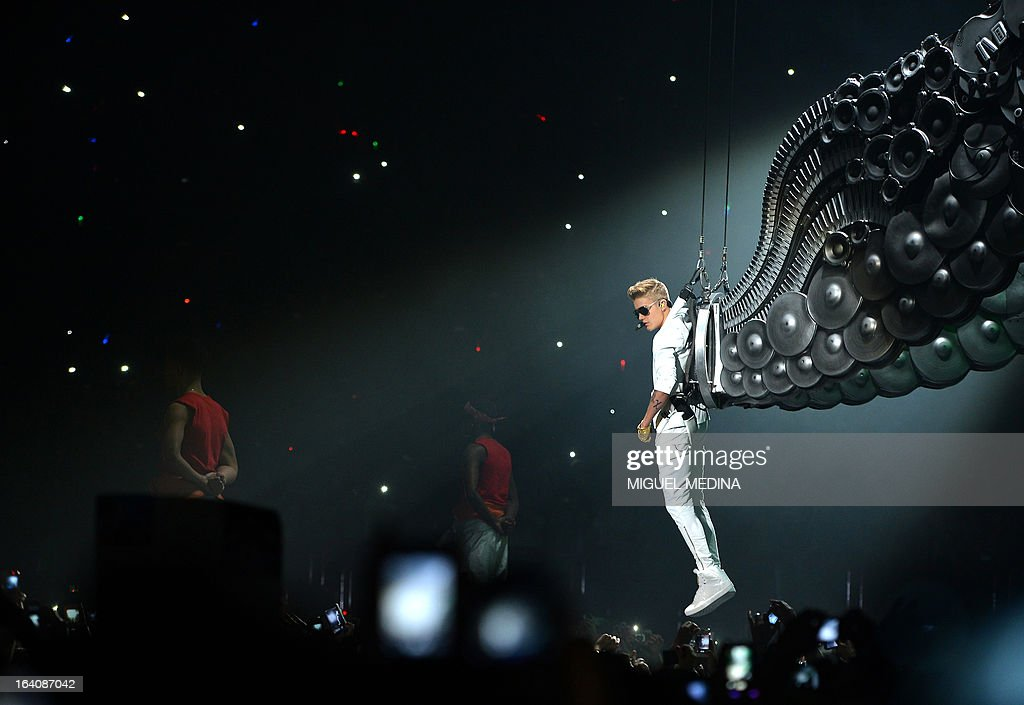 Canadian singer Justin Bieber performs during a concert as part of his 'I Believe' tour at the Palais Omnisport de Paris-Bercy (POPB), on March 19, 2013. AFP PHOTO / MIGUEL MEDINA