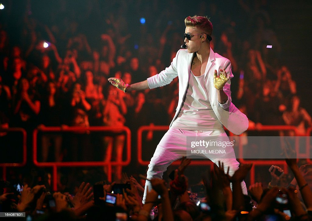 Canadian singer Justin Bieber performs during a concert as part of his 'I Believe' tour at the Palais Omnisport de Paris-Bercy (POPB), on March 19, 2013.