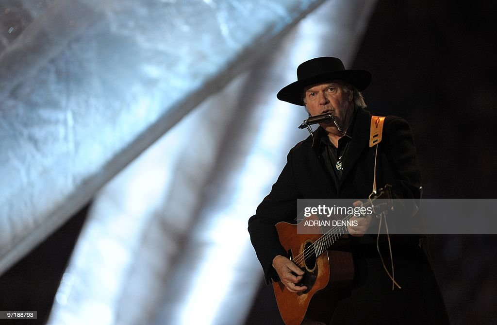 Canadian singer Neil Young performs during the closing ceremony of the 2010 Winter Olympics at BC Place in Vancouver on February 28, 2010.