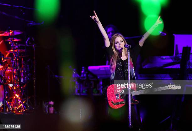 Canadian singersongwriter Avril Lavigne performs on stage as a part of '2012 Black Star Tour' at MasterCard Center on February 14 2012 in Beijing...
