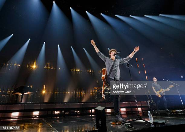 Canadian singersongwriter Shawn Mendes performs on stage during his 'Illuminate World Tour' at Rogers Arena on July 8 2017 in Vancouver Canada