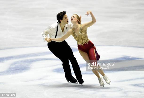 Canadian skaters Kaitlyn Weaver and Andrew Poje perform during their free dance of the ice dance event in the World Team Trophy figure skating...