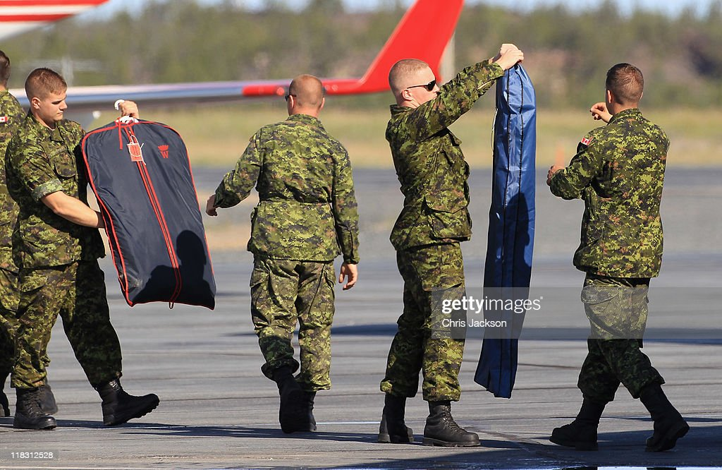 Canadian Soldiers load Prince William, Duke of Cambridge and Catherine, Duchess of Cambridge's luggage onto the Royal Plane at Yellowknife Airport on July 6, 2011 in Yellowknife, Northern Territories, Canada. The newly married Royal Couple are on the seventh day of their first joint overseas tour. The 12 day visit to North America is taking in some of the more remote areas of the country such as Prince Edward Island, Yellowknife and Calgary. The Royal couple started off their tour by joining millions of Canadians in taking part in Canada Day celebrations which mark Canada's 144th Birthday.