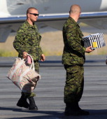 Canadian Soldiers load Prince William Duke of Cambridge and Catherine Duchess of Cambridge's luggage onto the Royal Plane at Yellowknife Airport on...