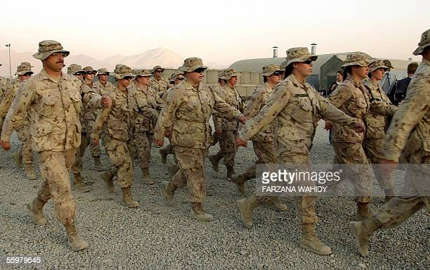 Canadian soldiers march after a ceremony at Camp Julien in Kabul 21 October 2005 The Canadian military ceremony marked the transfer of Canada's...