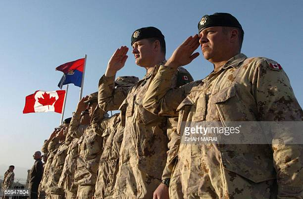 Canadian soldiers salute during a ceremony to mark the completion of their assignment with the International Security Asisstance Force at Camp Julien...