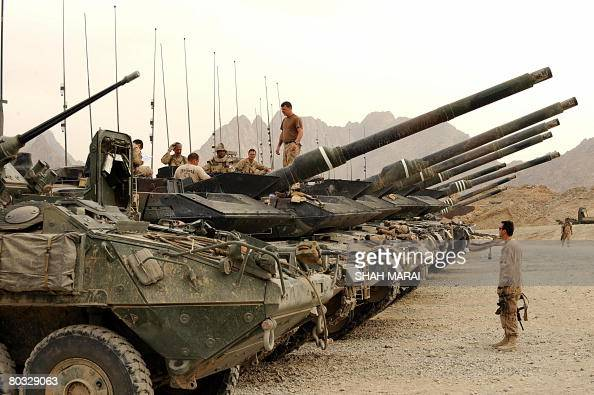 Canadian soldiers with the NATOled International Security Assistance Force stand on the top of their tanks as they prepare to go on a joint foot...