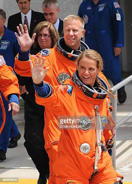 Canadian Space Agency astronaut Julie Payette and and mission specialist Tim Kopra wave as they joins the crew of the space shuttle Endeavour STS127...