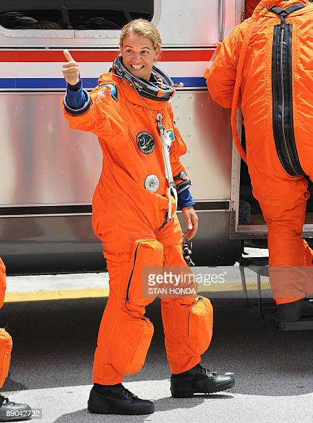 Canadian Space Agency astronaut Julie Payette joins the crew of the space shuttle Endeavour STS127 as they walk out to the astrovan July 15 2009 at...
