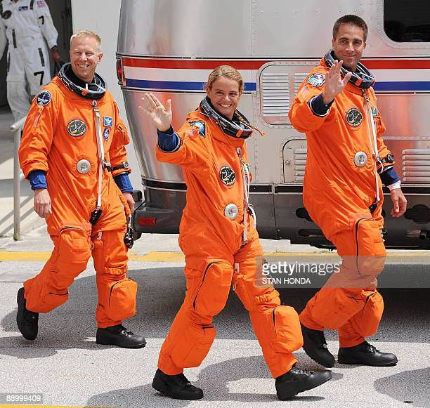 Canadian Space Agency astronaut Julie Payette waves as she joins the crew of the space shuttle Endeavour STS127 as they walk out to the astrovan July...