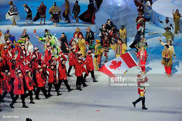 Canadian speed skater Clara Hughes carries the flag into BC Place during the opening ceremonies of the 2010 Vancouver winter Olympic games