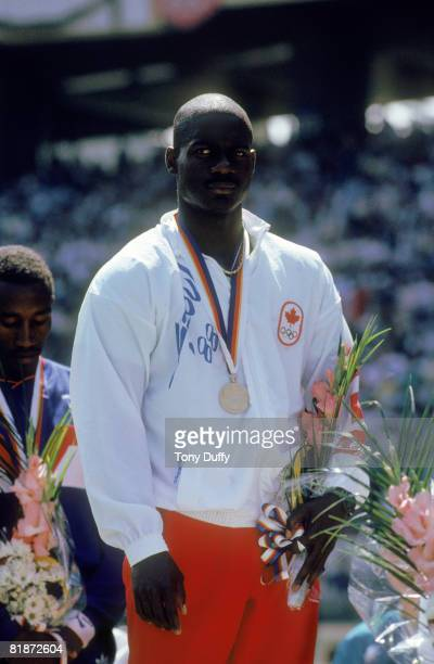 Canadian sprinter Ben Johnson on the winners podium with his gold medal after winning the 100 Metres event at Seoul Olympic Stadium during the...