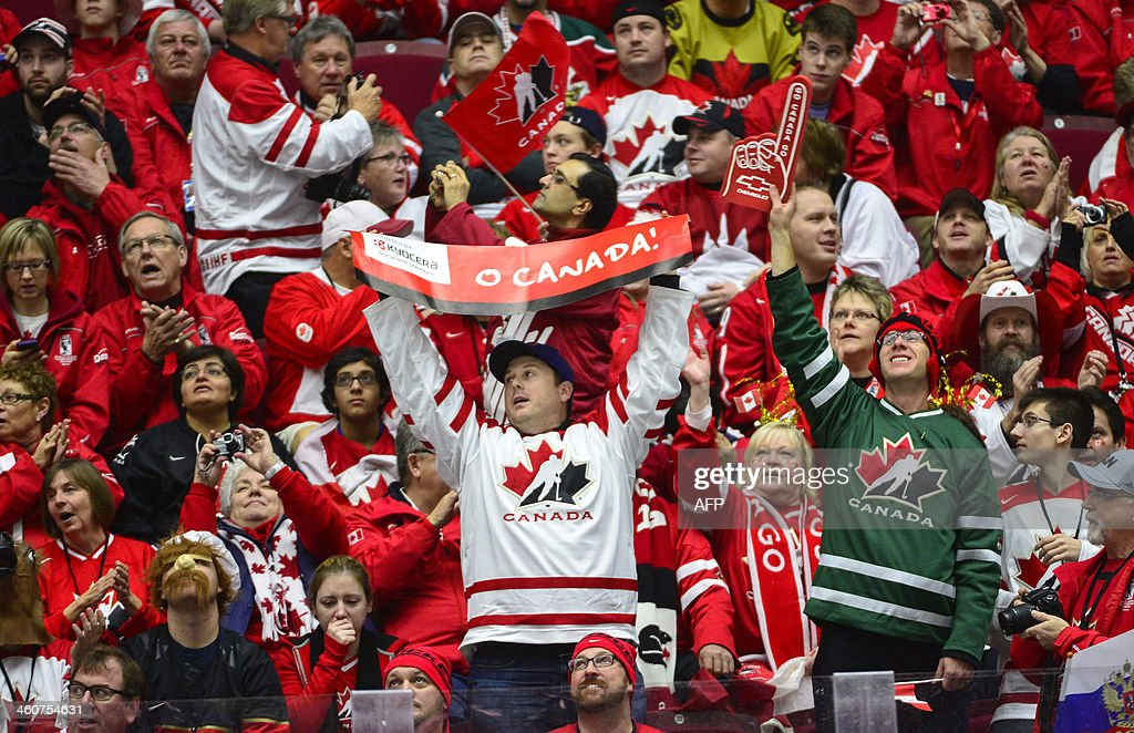 Canadian supporters warm up prior to the World Junior Hockey Championships bronze medal match between Canada and Russia at Malmo Arena in Malmo, Sweden on January 5, 2014.