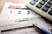 Canadian T1 form and April calendar on desk, tax season 2018 in Canada concept