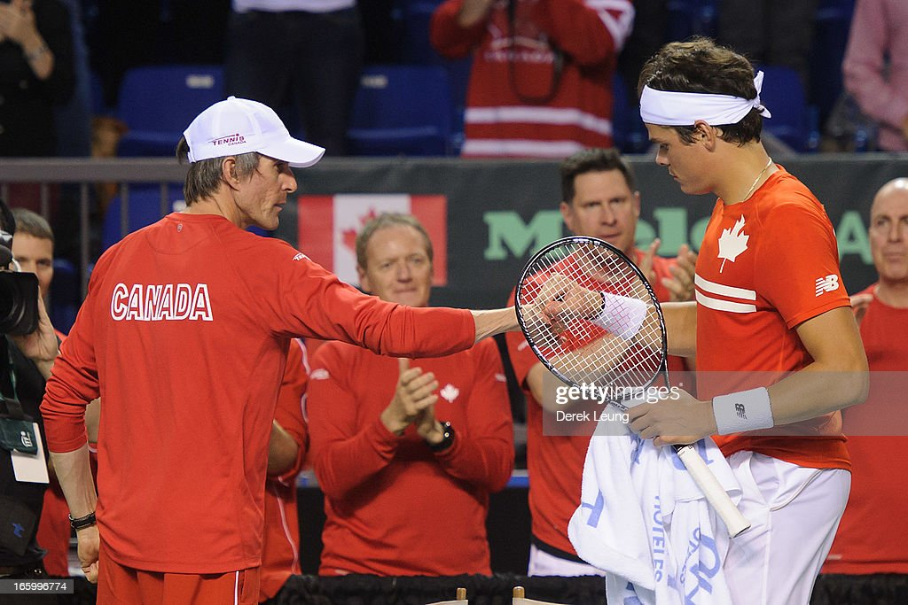 Canadian team captain Martin Laurendeau congratulates <a gi-track='captionPersonalityLinkClicked' href=/galleries/search?phrase=Milos+Raonic&family=editorial&specificpeople=5421226 ng-click='$event.stopPropagation()'>Milos Raonic</a> of Canada after winning a set against Andreas Seppi of Italy on day three of the 2013 Davis Cup quarterfinals on April 7, 2013 at Doug Mitchell Thunderbird Sports Centre in Vancouver, British Columbia, Canada.