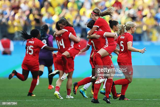 Canadian team celebrates as they clinch victory during the Women's Olympic Football Bronze Medal match between Brazil and Canada at Arena Corinthians...
