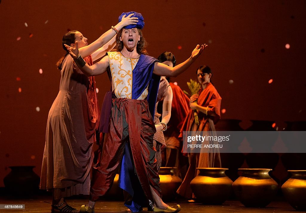 Canadian tenor David Curry (C) performs during a full dress rehearsal of the Opera 'A Flowering Tree' at the Chatelet theater on May 2, 2014 in Paris. The Opera by composer John Adams and staged by Indian director and screenwriter Vishal Bhardwaj, is inspired by a southern Indian folk tale describing the trials and tribulations of a young couple to demonstrate the power of love. It shows through May 5 - 13, 2014 at the Chatelet theater in Paris.