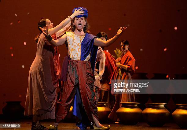 Canadian tenor David Curry performs during a full dress rehearsal of the Opera 'A Flowering Tree' at the Chatelet theater on May 2 2014 in Paris The...