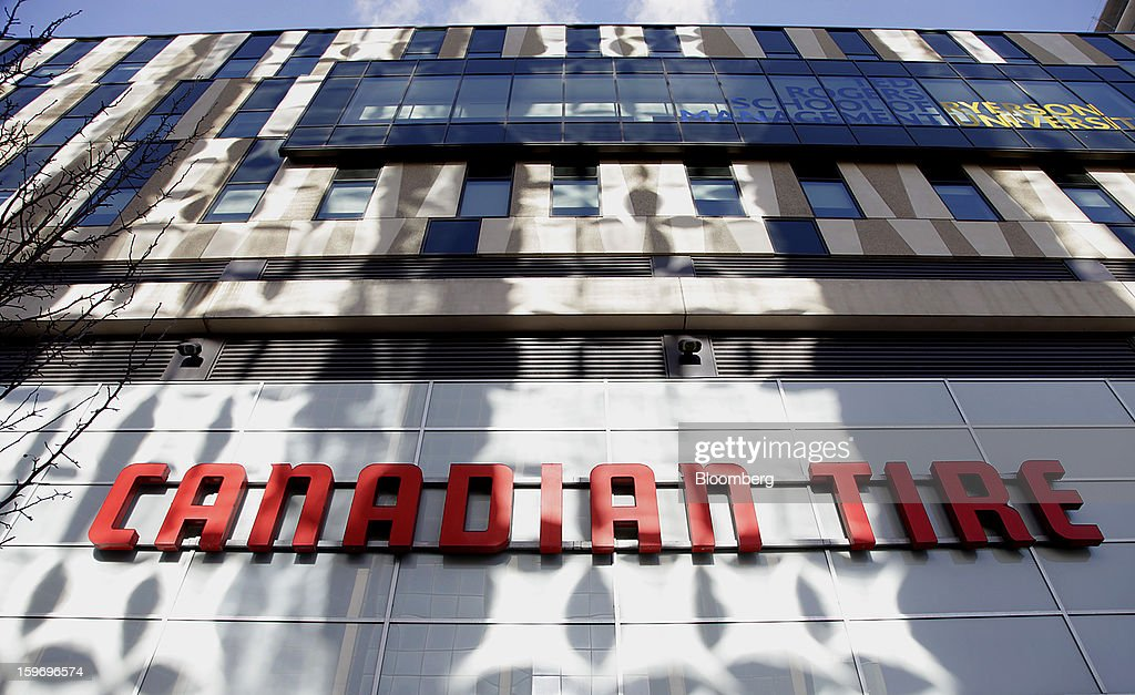 Canadian Tire Corp. signage is displayed outside of a store in Toronto, Ontario, Canada, on Friday, Jan. 18, 2013. STCA - Statistics Canada is scheduled to release retail sales data on Jan. 21. Photographer: Reynard Li/Bloomberg via Getty Images