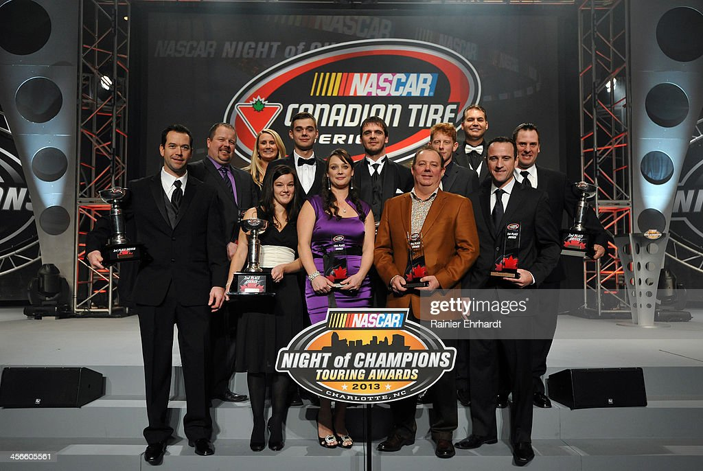Canadian Tire Series second through tenth place finishers and top three car owners pose for a photograph during the NASCAR Night of Champions at Charlotte Convention Center on December 14, 2013 in Charlotte, North Carolina.
