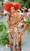 Canadian top model Yasmeen Ghauri presents 08 July in Paris an evening outfit consisting of a shapely fauxtiger painted ponyskin jacket rumpled with...
