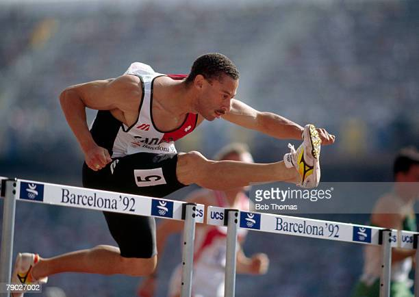 Canadian track and field athlete Mark McKoy competes to finish in first place to win the gold medal in the Men's 110 metres hurdles event at the 1992...