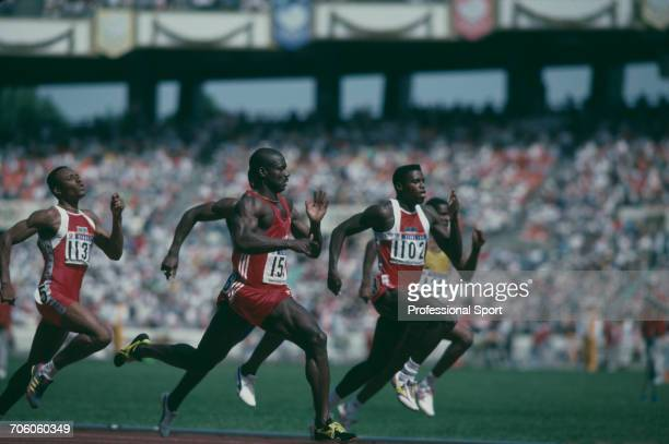 Canadian track athlete Ben Johnson competes to cross the finish line in first place to win the gold medal ahead of silver medallist Carl Lewis of the...