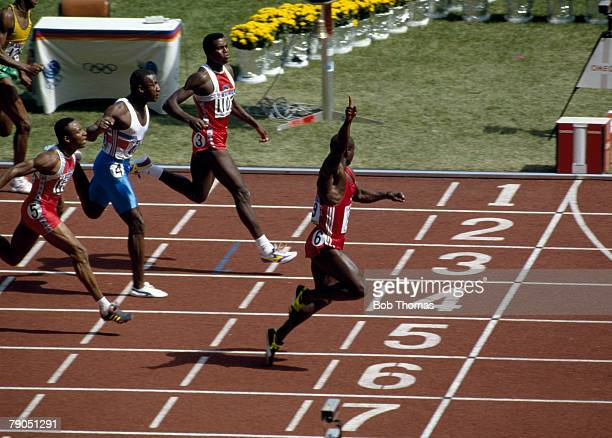 Canadian track athlete Ben Johnson crosses the finish line in first place to win the gold medal in the final of the Men's 100 metres event with Carl...